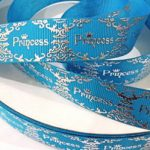 Silver foil princess and designs on purple grosgrain