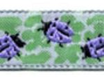 Lavender ladybugs on light green jacquard ribbon