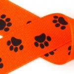 Black paws on dark orange grosgrain ribbon