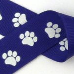 White paws on purple grosgrain ribbon
