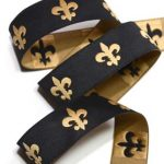 Gold Fleur de Lis on black jacquard ribbon