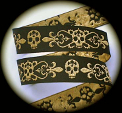 Gold skull and fleur de lis on black jacquard ribbon