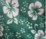 Green fleece with white hibiscus flowers