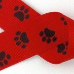 Black paws on red grosgrain ribbon