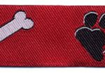 Black paw and white bone on red jacquard ribbon