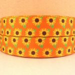 Yellow daisies on orange grosgrain ribbon