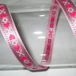 Purple hearts on silver metallic jacquard ribbon
