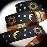 Sun, stars and Moon on black jacquard ribbon