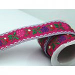 Pink and purple flowers with green on bright pink jacquard ribbon